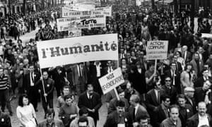A L'Humanité banner is raised during Paris protests in May 1968.