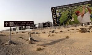 Donald Trump is depicted playing golf on a billboard at the Trump International Golf Club Dubai in the United Arab Emirates (UAE).