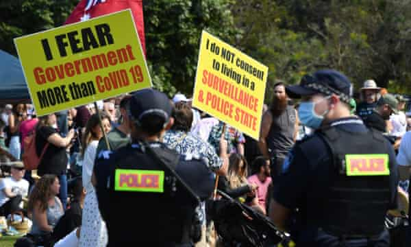 Protesters as Queensland police look on during the anti-lockdown rally in Brisbane