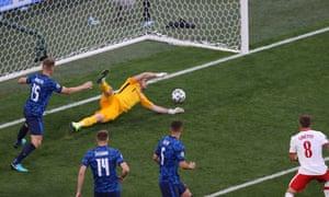 Poland's midfielder Karol Linetty (R) scores the equaliser.