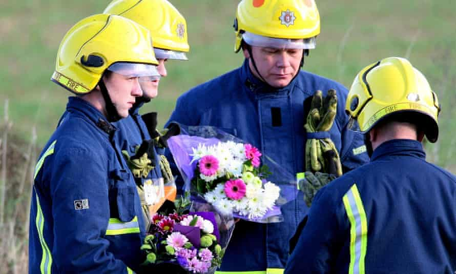 Firefighters arrive with floral tributes for their colleagues at Atherstone on Stour, Warwickshire