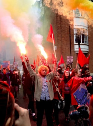 Protest with flares<br>Protesters wave flares as they march down the streets to Westminster.