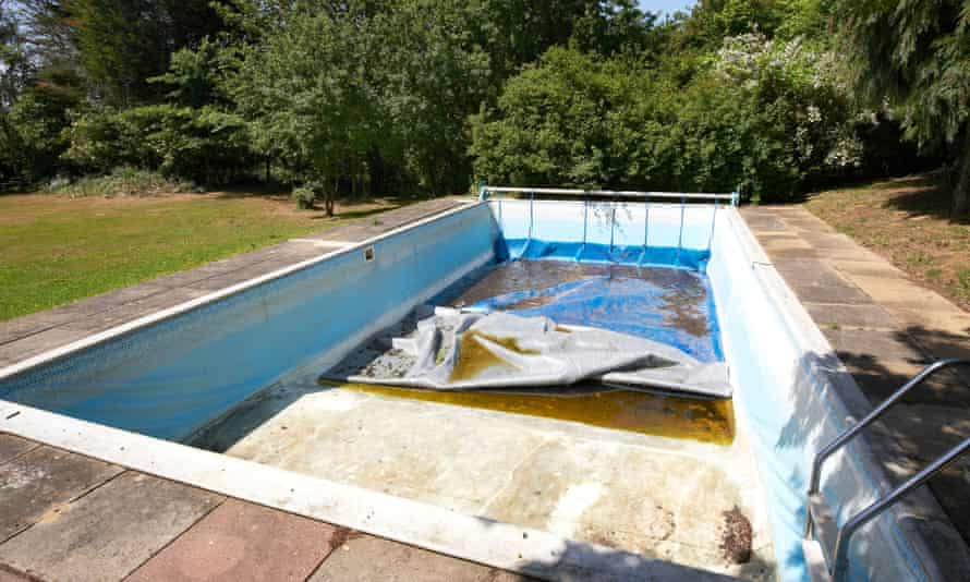An empty, untidy, private swimming pool