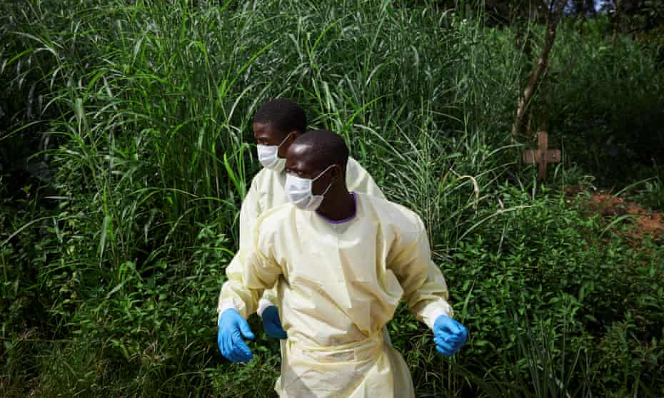 Health workers prepare to bury the body of a child killed by Ebola in North Kivu province.