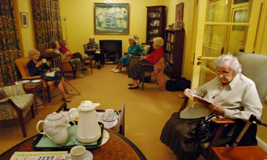 Mary Feilding residents having afternoon tea in the library.