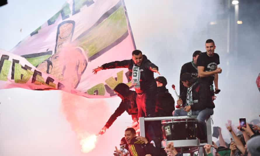 St Étienne fans enjoy themselves during their derby against Lyon.