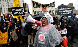 Workers in Harlem at a minimum wage rally. While New York and California have passes laws to raise the minimum wage to $15, Alabama's is stuck at $7.25.