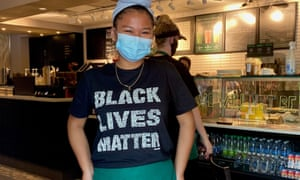 An mployee at Starbucks at the corner of Black Lives Matter Plaza, in Washington DC on 13 June.