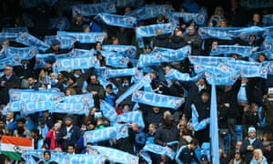 Manchester City fans hold up their scarfs prior to the 5-0 win over Burnley in the FA Cup fourth round.