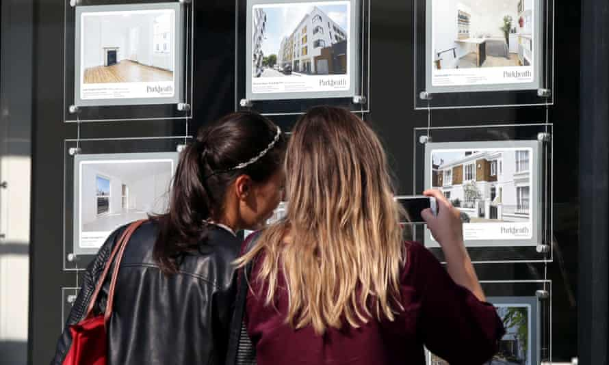 """Property mobility declineFile photo dated 08/06/16 of two women studying houses for sale in an estate agent's window in London as young Britons expect to make fewer house moves during their lifetime than the older generations did - in signs that """"property mobility"""" is declining - a survey has found. PRESS ASSOCIATION Photo. Issue date: Sunday November 6, 2016. People aged under 25 predict they will live in six properties typically during the course of their life, including the family home they grew up in, university accommodation and homes they rent or buy. See PA story MONEY Move. Photo credit should read: Yui Mok/PA Wire"""
