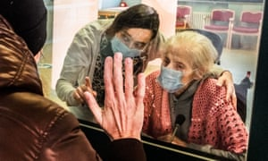 Protective glass allows guests to meet relatives during the Coronavirus outbreak in Milan