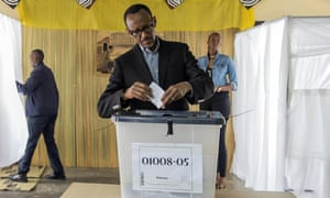 FILE - This is a Friday, Dec. 18, 2015 file photo of President of Rwanda, Paul Kagame as he casts his ballot, in Kigali. Rwandan President Paul Kagame declared Friday Jan. 1, 2016 that he will run for a third term in office after his second seven-year term expires in 2017, a move opposed by the U.S., a key ally. (AP Photo, File)