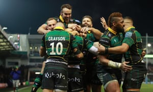 Northampton players celebrate Fraser Dingwall's try against Leicester.