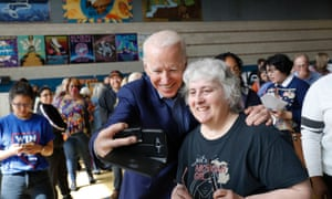 Joe Biden shoots selfies with voters at Cheyenne high school in North Las Vegas.