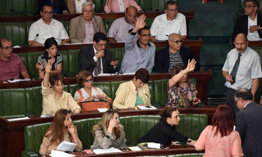 Tunisian MPs vote during the debate in parliament.
