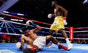 Amir Khan is knocked down by Terence Crawford. The boxer was forced to stop after a low blow 47 seconds into the sixth round.