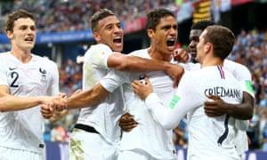 Raphaël Varane and France celebrate scoring the opening goal against Uruguay.