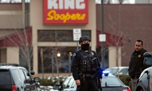 Police officers secure the perimeter of the King Soopers grocery store in Boulder, Colorado.