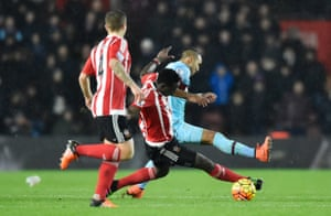 Victor Wanyama goes in recklessly as he attempts to tackle Dimitri Payet.