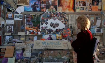 Participants look at the memorials left at the Temple Project.