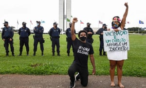 Protesters are seen in front of National Congress during in a motorcade demanding the impeachment of President Jair Bolsonaro and the access to the vaccine against COVID-19, in Brasilia on February 21, 2021.