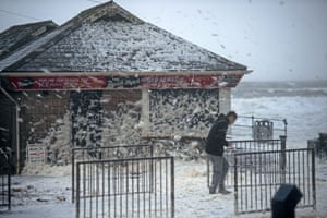 High winds whip up foam at Caswell Bay near Swansea