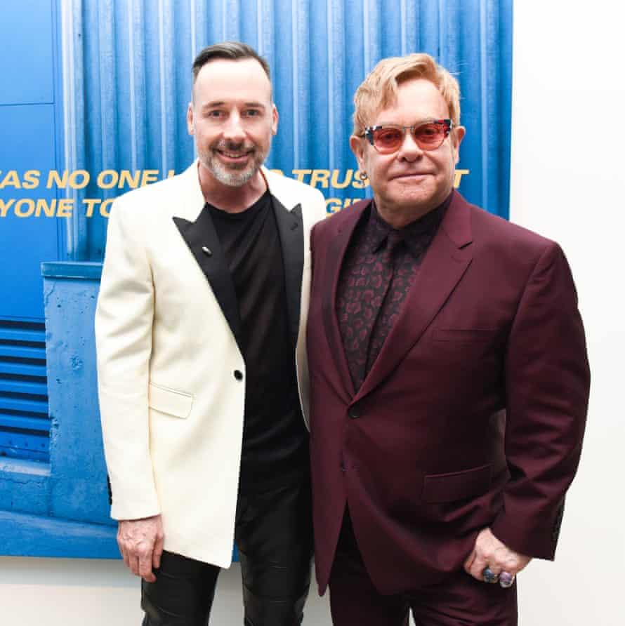 David Furnish and Elton John drop in at the opening.