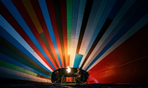 The patchwork hot-air balloon is inflated.