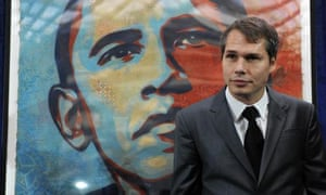 Shepard Fairey stands alongside his portrait of then US president-elect Barack Obama before it was installed at the National Portrait Gallery in Washington DC.
