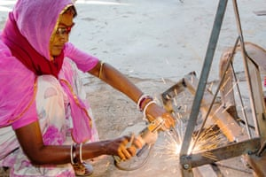 A women welding joints during the construction of a solar cooker at the Barefoot College in Tilonia, Rajasthan, India
