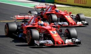 Ferrari drivers Sebastian Vettel, left, and Kimi Raikkonen after taking a 1-2 at the Hungaroring.