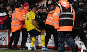 Pierre-Emerick Aubameyang celebrates scoring Arsenal's first goal with fans during the 1-1 draw at Bournemouth.