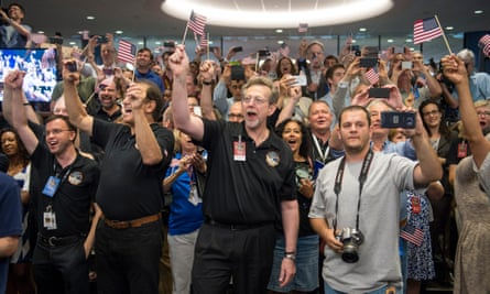 New Horizons team members count down to the spacecraft's closest approach to Pluto in July 2015