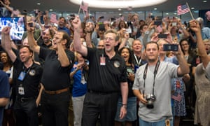 New Horizons team members count down to the spacecraft's closest approach to Pluto in July 2015.