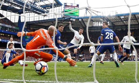 Dele Alli takes advantage of a defensive mix-up in the Chelsea box to tuck away Tottenham's third goal.