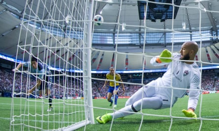 Tim Howard keeps out Christian Bolanos of Vancouver Whitecaps in the Rapids' 2-2 draw at the weekend.