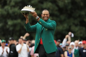 Tiger Woods celebrates with the Masters Trophy.