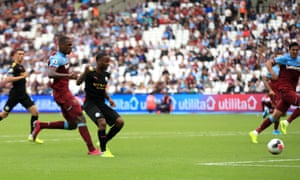 Manchester City's Raheem Sterling scores his side's fifth goal of the game.