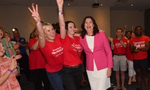 Queensland premier Annastacia Palaszczuk celebrates victory with her sisters Julia, left, and Nadia, centre, at the Blue Fin Fishing Club