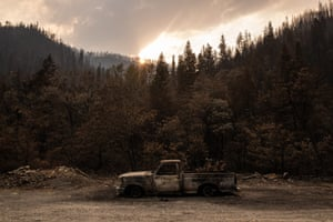 A burned out pickup truck among a scorched forest in Happy Camp.