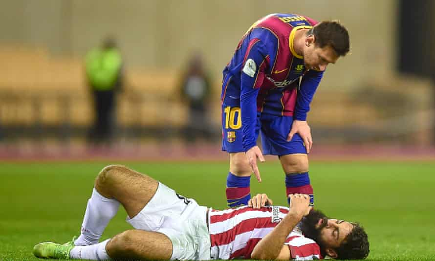 Lionel Messi stands over Asier Villalibre after felling the Atlético player.
