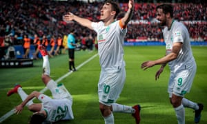 Werder Bremen's Max Kruse celebrates with his teammates after scoring his side's third goal in injury time.