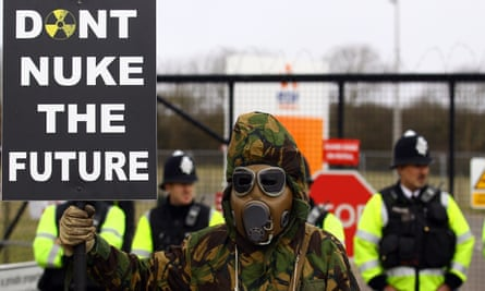 A protestor at the gates of the Hinkley Point nuclear site