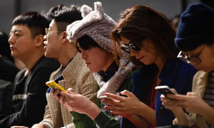 People looking at mobile phones