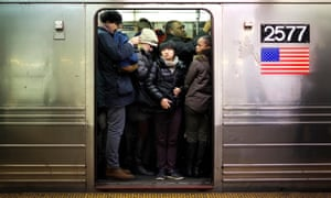 Commuters cram onto a subway train at 42nd Street Station in New York City. The October non-farm payrolls report is expected to show a rebound in US jobs.