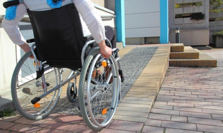 Woman in a wheelchair using a ramp.