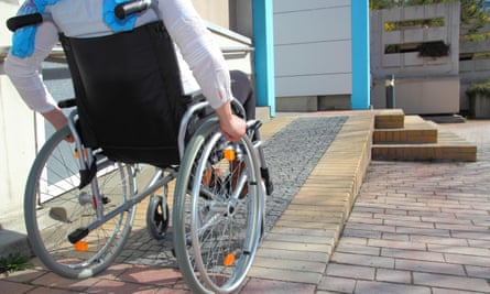 A wheelchair-user using a ramp