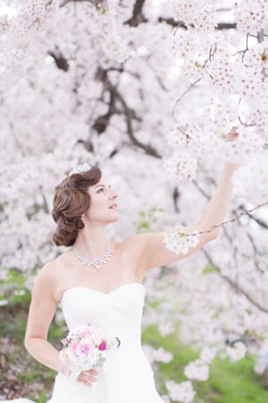 Naomi Harris poses for a wedding picture in a Japanese garden with cherry blossom