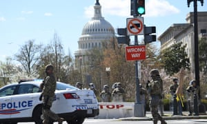 Members of the police and national guard block a street near the US Capitol today.