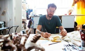 Material world: Alex Noble at work, sitting at a table drawing.